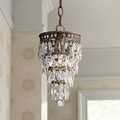 Add romance to home decor with this antique brass finish, mini crystal chandelier. high x 6 wide x canopy is 4 round x hanging weight is lbs. Includes 6 feet of chain, 12 feet of wire. Style # at Lamps Plus. Sparkling Lights, Mini Chandelier, Crystal Ball, Sale Items, Antique Brass, Pendant Lighting, Light Fixtures, Sparkle, Ceiling Lights