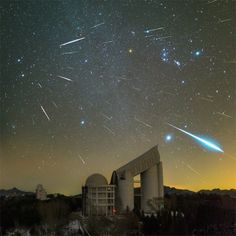 """Yu Jun's Geminids over the Lamost telescope shows a night's worth of meteors over an observatory in China. """"This picture shows all these meteors, grains of dust burning up high the atmosphere,"""" said Dr Kukula. """"Because the photographer has composited all the meteors from one night, you can see they all come from one spot in the sky."""