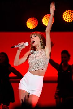 Taylor Swift Photos Photos - Singer Taylor Swift performs onstage during We Can Survive 2014 at the Hollywood Bowl on October 24, 2014 in Los Angeles, California. - We Can Survive 2014