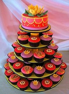 Bollywood Cake~I'm all about cupcakes and I was so excited to find this pin. These lovely colorful cupcakes just scream Indian wedding! They look delicious too.