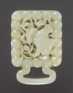 Belt slide, Jin (1115–1234)–Yuan (1271–1368) dynasty, 12th–14th century  China  Jade (Nephrite)