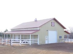 Metal pole barn with red roof