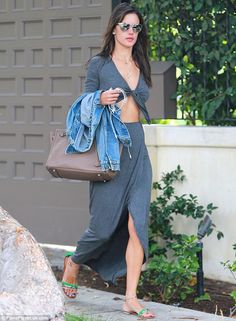 Showing off: Alessandra Ambrosio stepped out in a sexy cut-out maxi dress as she headed to a limo outside her home in Brentwood, California ...
