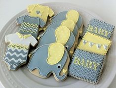 Decorated Elephant Themed Baby Shower Cookies- Custom Grey, Yellow, and White Chevrons, Onesies, Personalized Pennants on Etsy, $48.00 by deana