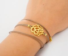 wrapped bracelet - cord wrap bracelet with a gold plated rose charm - brown string bracelet, elegant bracelet - adjustable with an extension. $13.00, via Etsy.