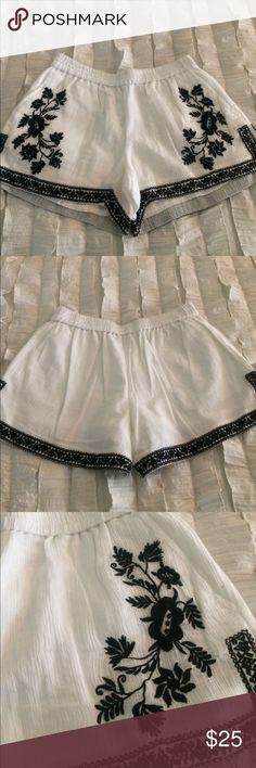 J.Crew Shorts Adorable white shorts with black Floral design and black trim!  Size 00.  Perfect for the summer!  Elastic waistband.  Fits true to size. J. Crew Shorts