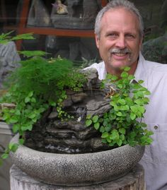 Item Number: SS49 Bowl Style: Large Lotus Bowl Color:Textured Grey Stone Bowl Size: 18in. diameter Approximate Height: 11″ to 13″ (from top of plants to bottom of bowl) Lush foliage of self-watering live plant outline this natural stream. This tabletop fountain has a soothing rhythmic tone. Perfect for relaxation.