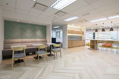 Veeam Software office by Raw Design Consultants Kuala Lumpur Malaysia Office Canteen, Staff Lounge, Office Entrance, Open Office, Office Spaces, Staff Room, Built In Seating, Lunch Room, Lounge Design