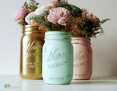 **MINT, BLUSH AND GOLD ARE AMONG THE TOP COLORS FOR SPRING 2014 WEDDINGS** These gorgeous painted mason jars are perfect for wedding centerpieces