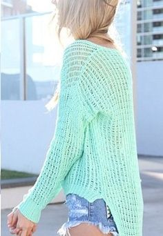 Mint green knit sweater.