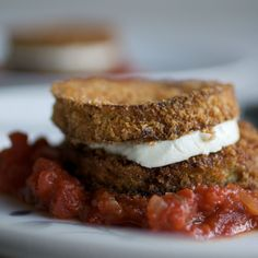 Golden eggplant slices sandwich tangy, melting cheese, all set off by a fast tomato sauce flavored with the unusually complementary tarragon.    S...