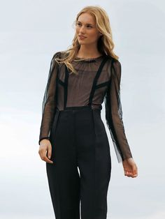 This top is so unique and lovely to wear! It is made from black sheer tulle, and the overlap of seams create beautiful stylelines.