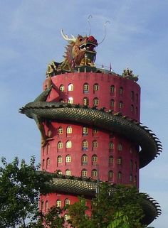 Dragon Temple, Bangkok, Thailand  photo via  julianne.  Cute, but I don't want to be hugged by a Dragon every night.