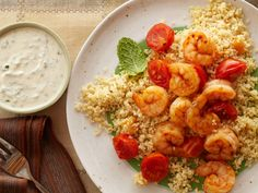 Shrimp and Couscous With Yogurt-Hummus Sauce : This speedy shrimp dish gets you whole grains, protein, vegetables and fruit all ready to go in 5 minutes (Pro tip: prep the couscous while the shrimp broils.) via Food Network Sauce Recipes, Seafood Recipes, Dinner Recipes, Food Network Recipes, Cooking Recipes, Healthy Recipes, Healthy Dinners, Fast Meals, Weeknight Recipes