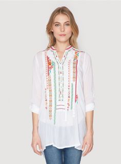 Leanna Tunic The Johnny Was Collection LEANNA TUNIC is all about detail. Channel gypset style in this embroidered blouse, which is adorned by a variety of unique, colorful geometric embroidery motifs along the front and shoulders. A truly one-of-a-kind top, you'll treasure the LEANNA TUNIC for years to come!  - Rayon Georgette - V-Neck with Henley Button Front, Tabbed Long Sleeves - Signature Embroidery - Care Instructions: Machine Wash Cold, Tumble Dry Low