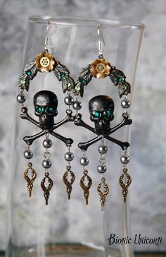 perfect for that pirate steampunk look you were going for. (Steampunk Skull Earrings - Black Skull and Crossbones with Emerald Green Swarovski Crystals Flowers and Steampunk Charms bionicunicorn - etsy.com)