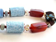 Artistic fiber necklace in honey and corn flower blue by Gilgulim, $49.00