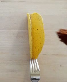 When loading up a taco with ingredients, use a fork to keep it from falling over.