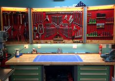 Organized to perfection! Wall Control Red Metal Pegboard being used here in a custom pegboard cabinet. Customer Clark created a beautiful wooden hinged pegboard cabinet that can be opened and closed. A very creative, functional, and attractive use of Wall Control Metal Pegboard. Thanks for the great customer submission Clark!