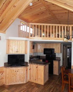 Enjoy this cozy cabin, just steps from Lake Fork! Free WiFi, satellite TV, fully equipped kitchen, and spacious living area! www.popeslanding.com