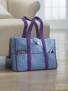 You can never have too many closets or too many pockets. Get organized with this great big tote with places for all your gadgets and essentials. Interesting texture is created by alternating single and double crochet stitches in one row, then working singles in the doubles and doubles in the singles in the next row. Copyrighted materials from the book, HOOKED BAGS, used with permission from Creative Publishing international. (Lion Brand Yarn)