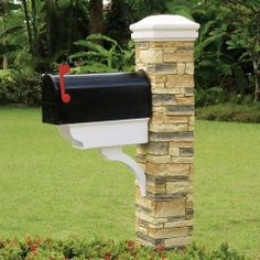 Beige Stacked Stone Newspaper Holder And Curved Cap Mailbox Post