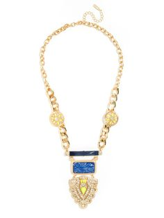 Flush with ancient appeal, bold metal links and precious gemstones, this statement necklace is not for the faint of heart.