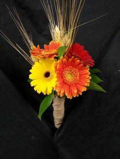 Fall colored gerbera daisies for bridesmaids. Country burlap wedding
