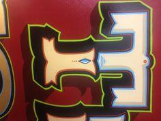 Hand lettered sign. Artist Chris Dobell