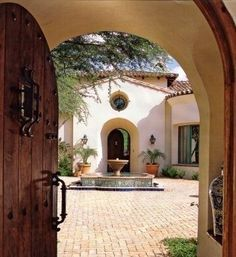 I don't know what's up with me and Spanish and Italian style architecture and design but I love it.: The Doors, Court Yards, Home Exterior, Spanish Courtyards, Front Doors, Spanish Style Home, Landscapes Design, Spanish Architecture, Clay Tile