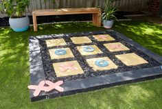 Turn a tired old area into a fun game zone with this giant noughts and crosses game. It'll get the kids outside and keep them entertained for hours - even the adults can get involved. #kids #diy #backyard