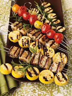 [ Recipe: Pork & Veggie Kebabs ] and other Healthy Grilling Recipes for a Summer BBQ. Kebabs made with: olive oil, garlic cloves, lemon, flat-leaf parsley, fresh rosemary, fresh thyme, sugar, salt, black pepper, boneless pork chops, zucchini, summer squash, and cherry tomatoes. ~ from Fitness Magazine.