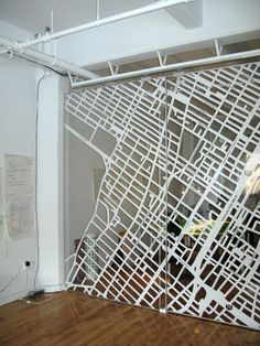 The screen is a 10 foot high acrylic divider made by the Rita design studio. It's got a map of the neighborhood on it that used to identify places liked around the office, mostly restaurants and coffee shops for the moment.