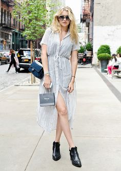 Gigi Hadid in a summery button-front dress and sleek black ankle boots