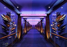 Take in the art on the walk to the casino onboard Allure of the Seas.
