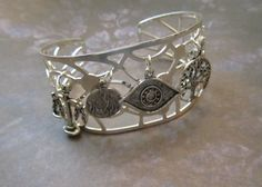 Divergent Inspired 5 Factions Charm Cuff Bracelet - Dauntless Candor Erudite Amity and Abnegation on Etsy, $25.00