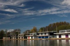 The many boat houses of the colleges.  Famous Rowing competition every year between Oxford and Cambridge Universities