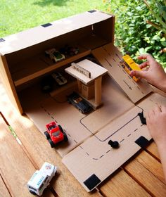 Don't throw away those sturdy cardboard boxes just yet - transform one into a cool DIY parking garage complete with a ramp to house all of your Hot Wheels! So speedy and easy to make, you won't believe it!