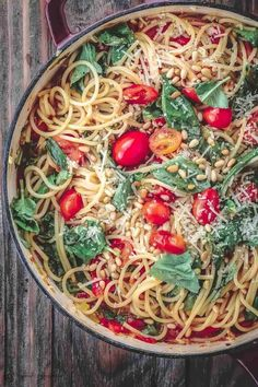 Easy Chicken Spaghetti with Tomatoes and Basil will be a favorite at your dinner table. Full of flavor this is the perfect weeknight dinner idea for your family!  | The Mediterranean Dish