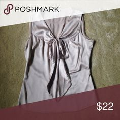 """Champagne colored silk H&M top Gorgeous champagne colored silk top from H&M with front bow detail. 98% silk 2% spandex. Size 4. Measures 17"""" across so chest measurement is 34"""". H&M Tops"""