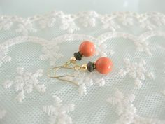 Sweet and pretty swarovski pearl earrings in coral by beadpod8, $12.00