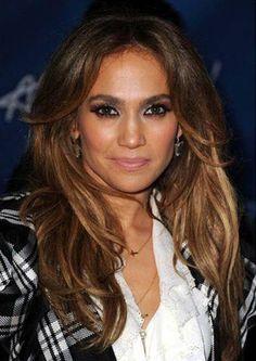 Jennifer Lopez wearing Roseark Sideways Cross Necklace.