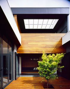 courtyard with combined vertical/horizontal siding, grey and wood