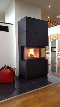 Enjoy fire from three sides. Heat storage and . Enjoy fire from three sides. Heat storage and wooden compartments are Stove Fireplace, Modern Fireplace, Ikea Hack, Modern Farmhouse, Sweet Home, New Homes, Decoration, Home Appliances, House Design