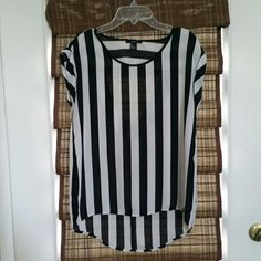 Forever 21 striped top Forever 21 black and white striped top. Has tiny stain about the size of a pen mark on the front. Besides that great condition! Forever 21 Tops
