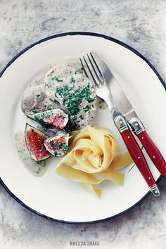 Rosemary pork tenderloin in creamy fig sauce served with tagliatelle