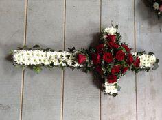 Funeral Flowers. Funeral cross, funeral tribute, funeral flowers, red rose based cross, red rose funeral cross  www.thefloralartstudio.co.uk