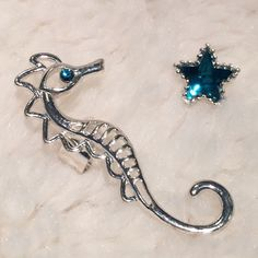 2pc. Seahorse & Starfish Earcuff Set NWT. No piercing required for the seahorse. Comes with star for the opposite ear. NO TRADES Quinn-Tessential Designs Jewelry Earrings