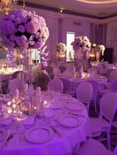 Domes of ivory hydrangea, roses and orchids  atop glass Zalia vase at Claridge's