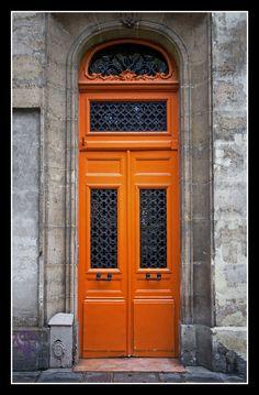 Typical Parisian door in de Marais neighbourhood of Place des Vosges in Paris, IIe-de-France_ North France   ..rh